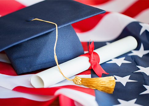 Graduate hat on US flag